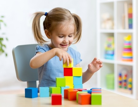 46065199 - child little girl playing wooden toys at home or kindergarten